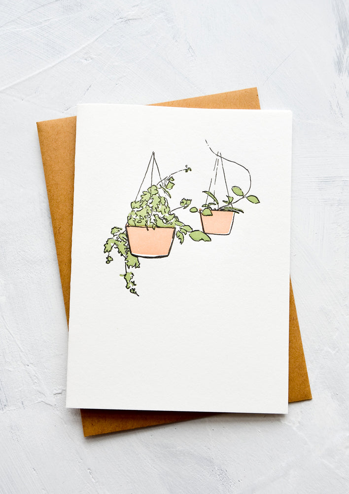1: A letterpress printed greeting card with an image of two hanging pots with plants