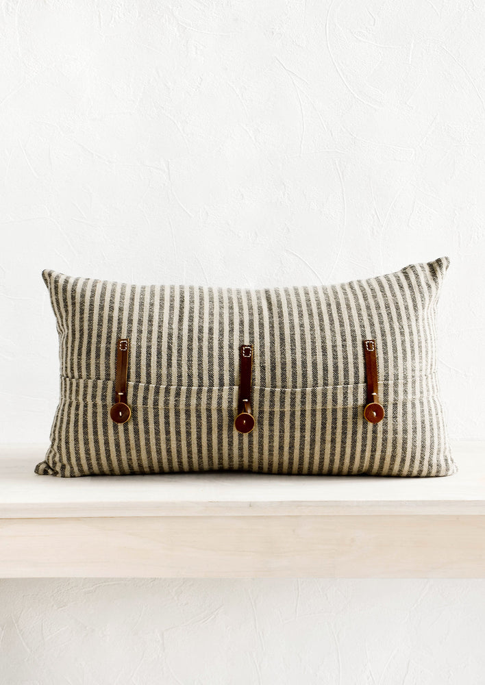 Striped cotton lumbar pillow in black and beige with decorative leather button detailing