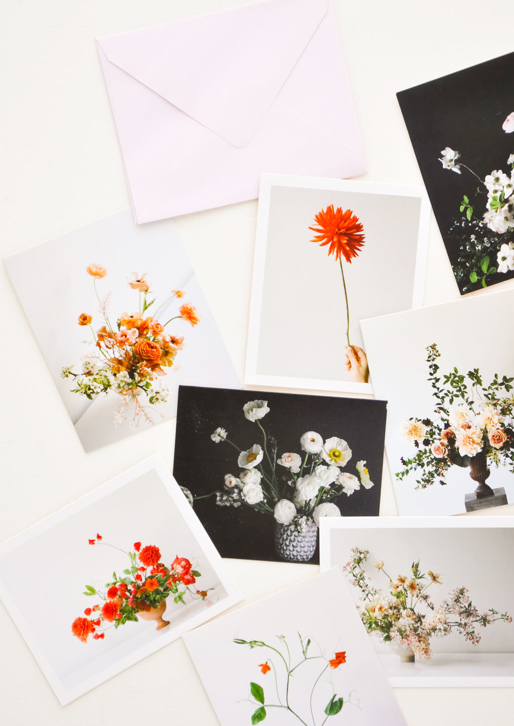 1: Product show showing multiple styles of floral photography notecards.