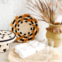 4: Variety of tabletop home decor in a neutral, earthy palette