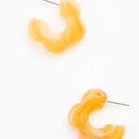 Apricot Candy: Acetate earrings in the shape of a daisy-like flower, marbled translucent apricot color
