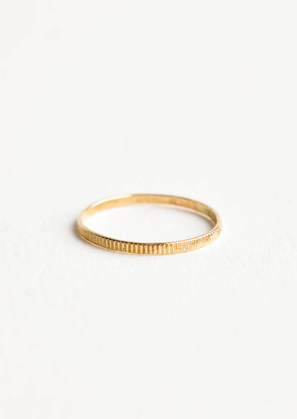 1: Yellow gold ring with etched decorative markings around the band.