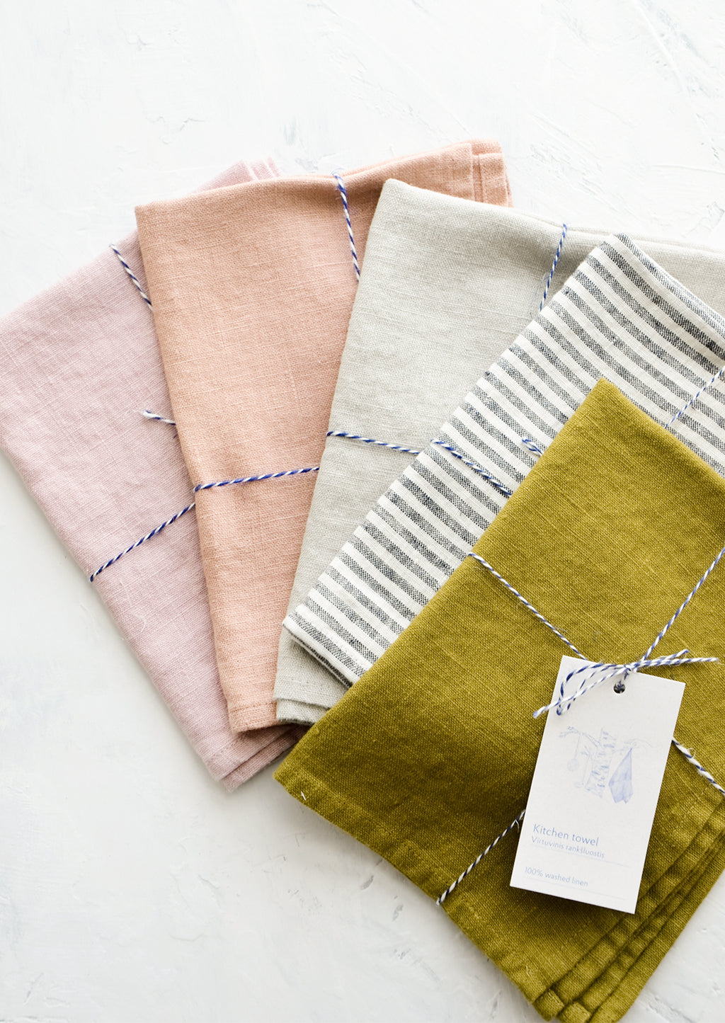 1: An array of colorful linen tea towels