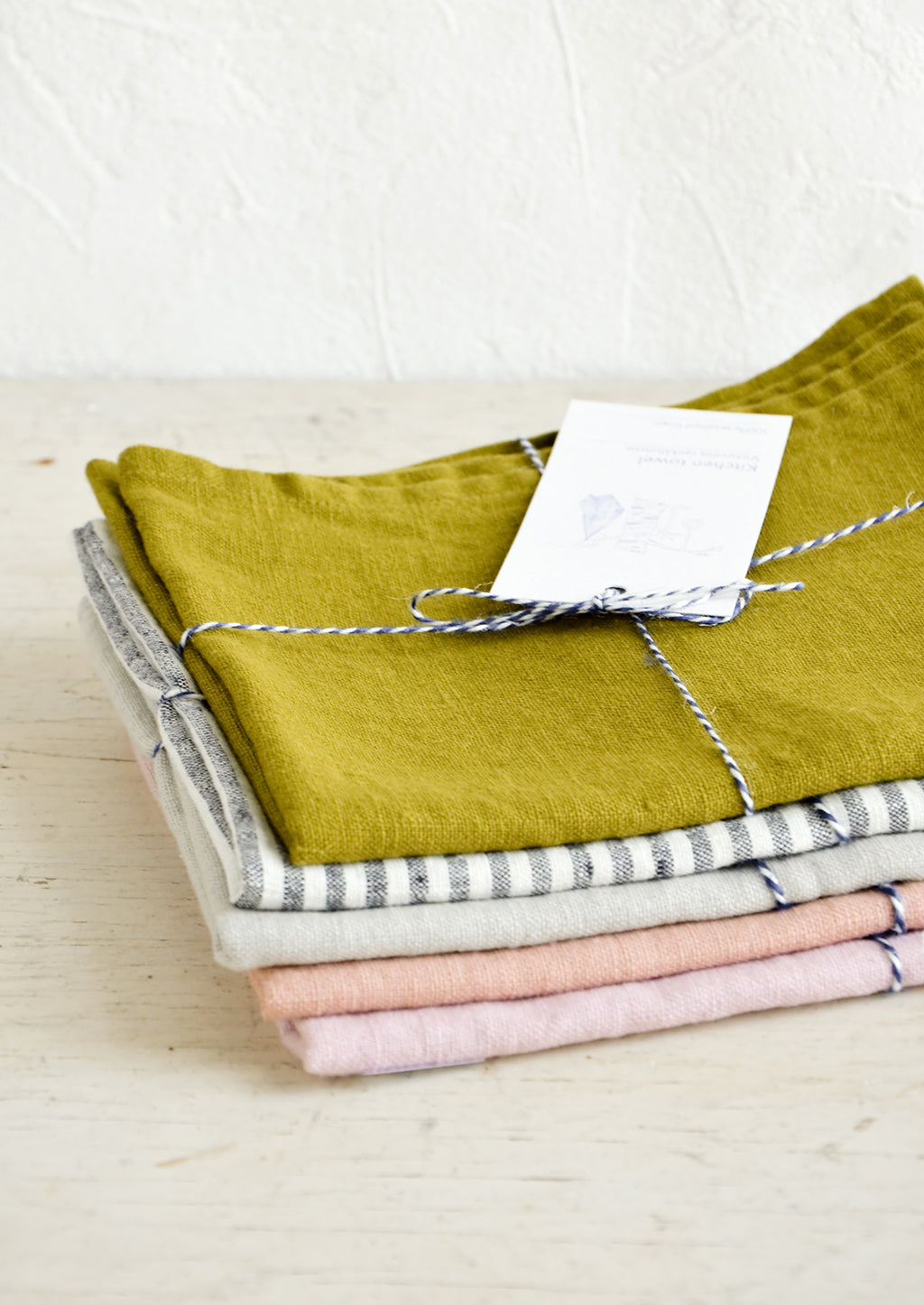 2: A stack of folded colorful linen kitchen towels