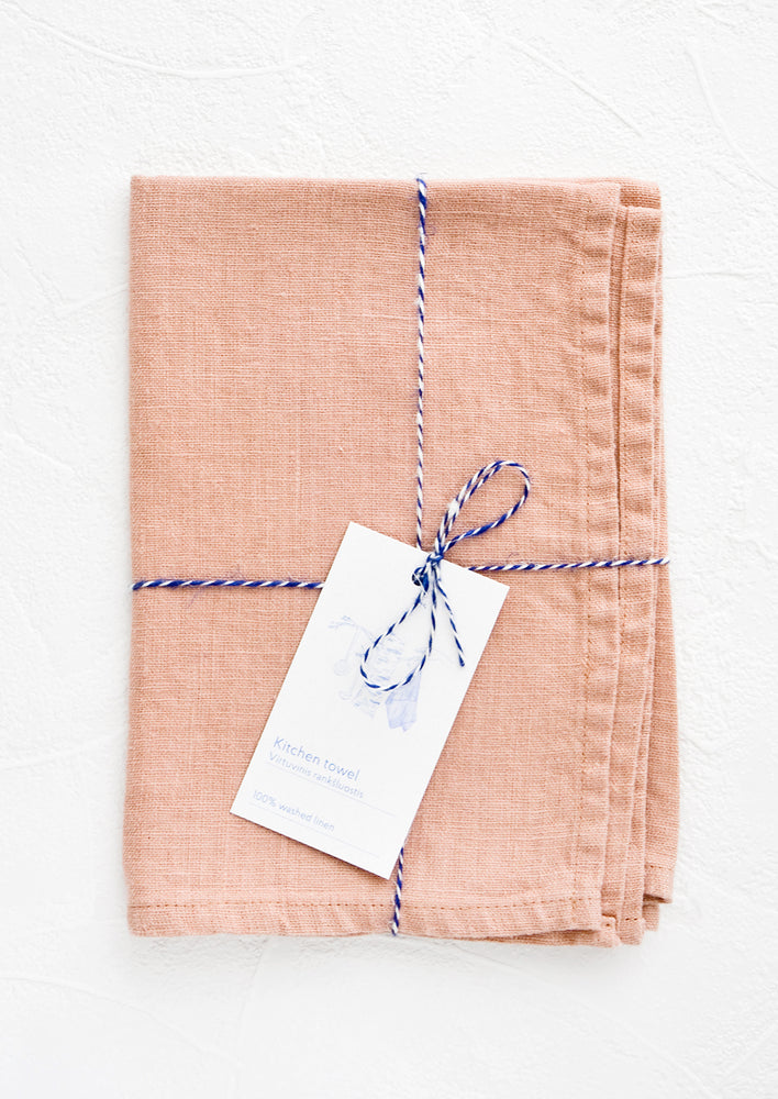 Tea Rose: A folded pink linen tea towel tied in baker's twine with a decorative hangtag.