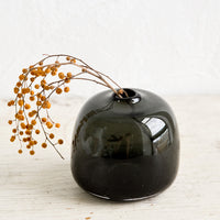 Bubble / Shadow: A round, bubble shaped vase in charcoal with dried mimosa.