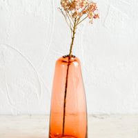 Tall / Cherry: A tall glass bud vase in translucent red-orange.