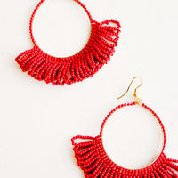 Cherry: Dangling hoop earrings featuring bright red beads and accented with hanging beaded, looped fringe.