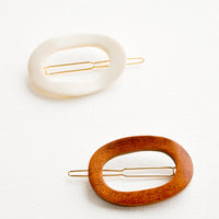 4: One brown and one white oval shaped hair clip