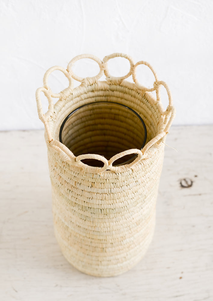 3: A natural raffia vase with concealed glass vase insert.