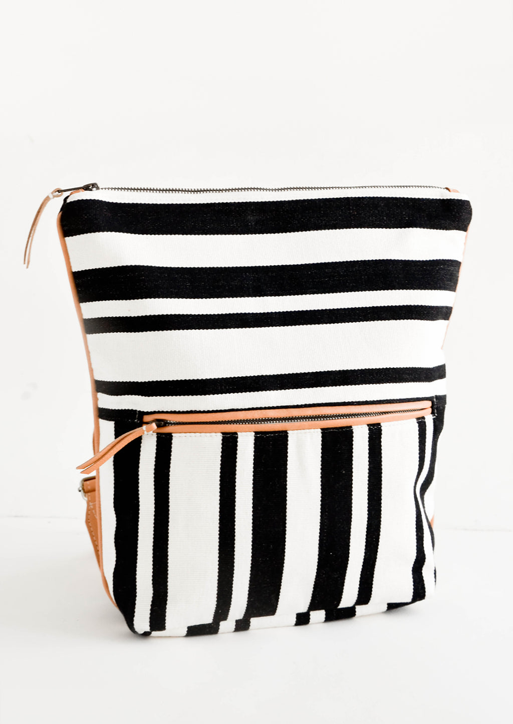 1: Fashion backpack in black and white striped cotton canvas with tan leather accents