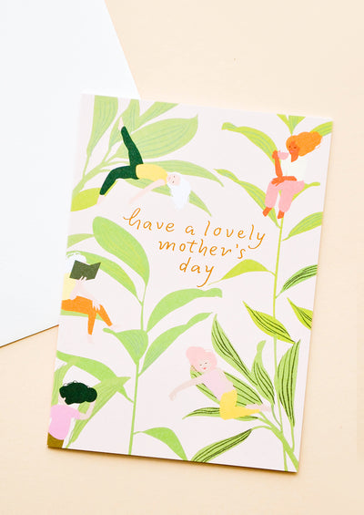 "Greeting card with botanical pattern and ""Have a lovely mother's day"" text."