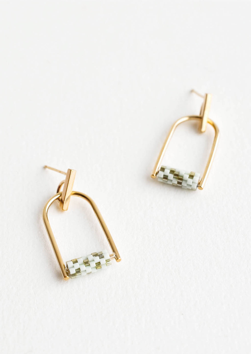 1: Arced gold post back earrings with mint and olive green beads closing off the arc.