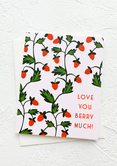 "A greeting card with illustration of a strawberry patch and text at corner reads ""Love you berry much!"""