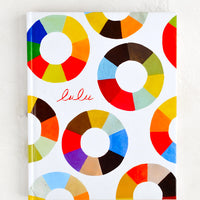 1: A colorful hardcover book cover with multicolor pinwheels.