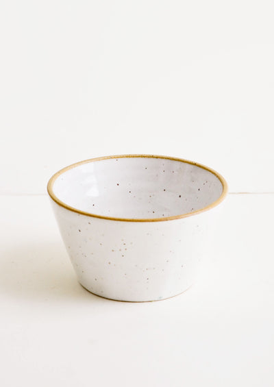 Handmade ceramic rice bowl in speckled white glaze
