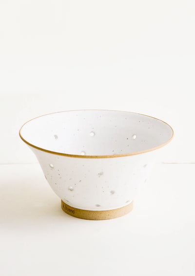 Ceramic colander in white ceramic with raw clay accents