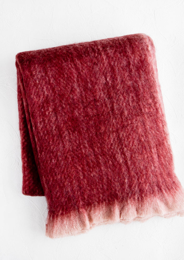 2: Fuzzy, mohair-like throw blanket in wine red with faded fringe trim