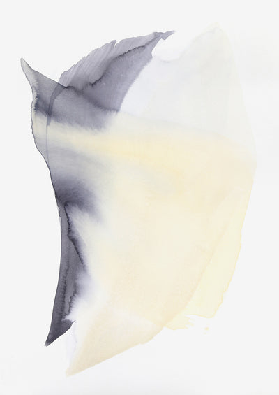 A swooping form created by yellow and charcoal watercolor paint seems to be moving on its white canvas.