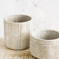 4: Distressed planters in concrete-like texture, in two different sizes with varying patterns