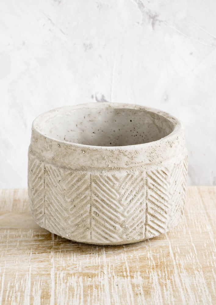 Low: Distressed planter in concrete-like texture with chevron  detailing