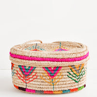 Multicolor: Rounded box style straw bag with neon multicolored flower pattern.