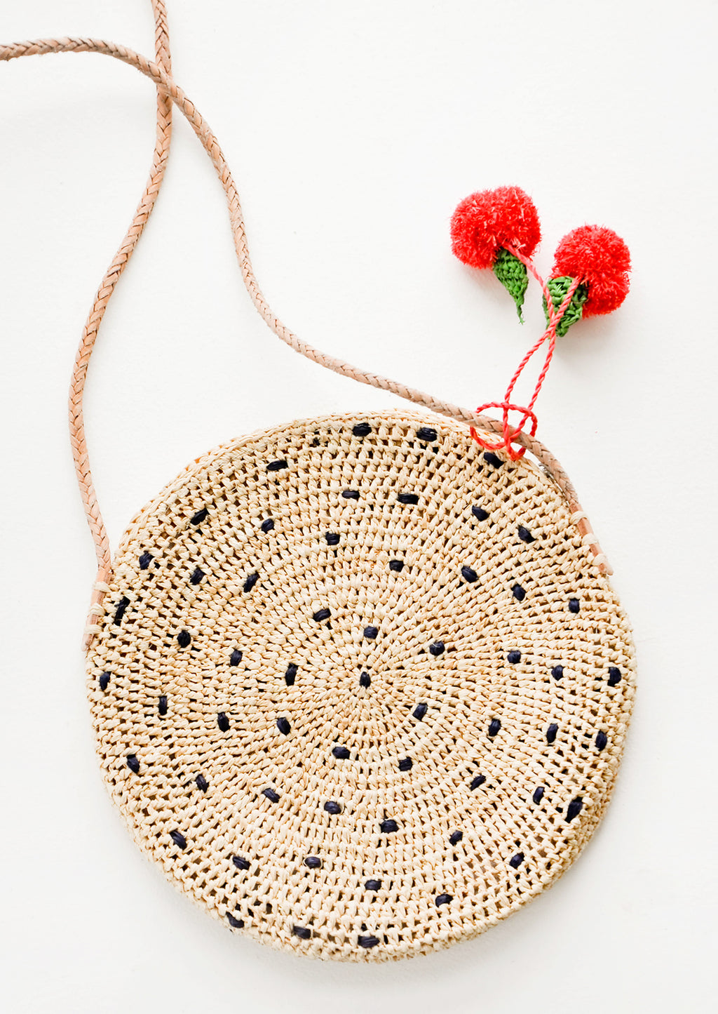1: Fruit Pom Straw Crossbody Bag in  - LEIF