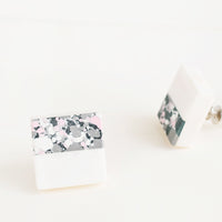 2: Square cabinet knob with white marble bottom half and splattered paint top half