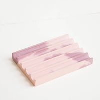 Mauve / Pink: A marbled pale pink and mauve smooth concrete soap dish with troughs and ridges.