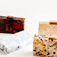 2: Box shape clutches in a mix of patterned resin materials