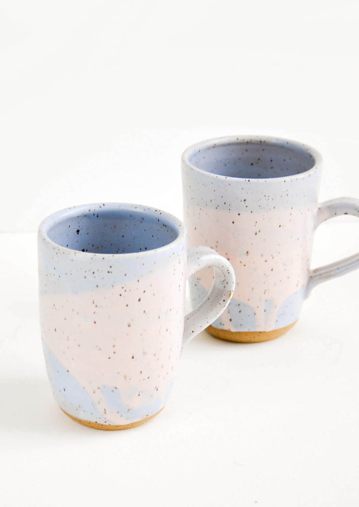 Periwinkle / Pink: Two ceramic mugs in blue and pink with brown speckles.