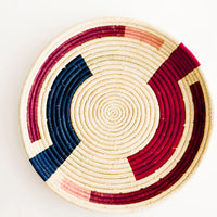 Berry Multi: Geometric Printed Round Raffia Serving Tray in Berry Multi - LEIF