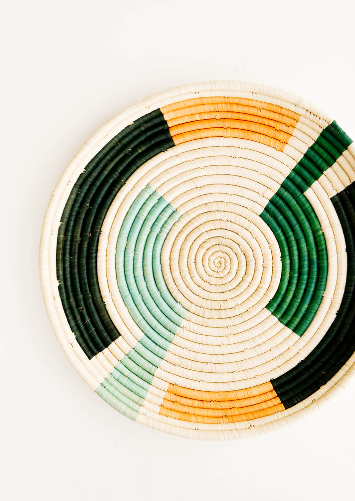 Forest Multi: Geometric Patterned Round Raffia Serving Tray in Forest Multi - LEIF