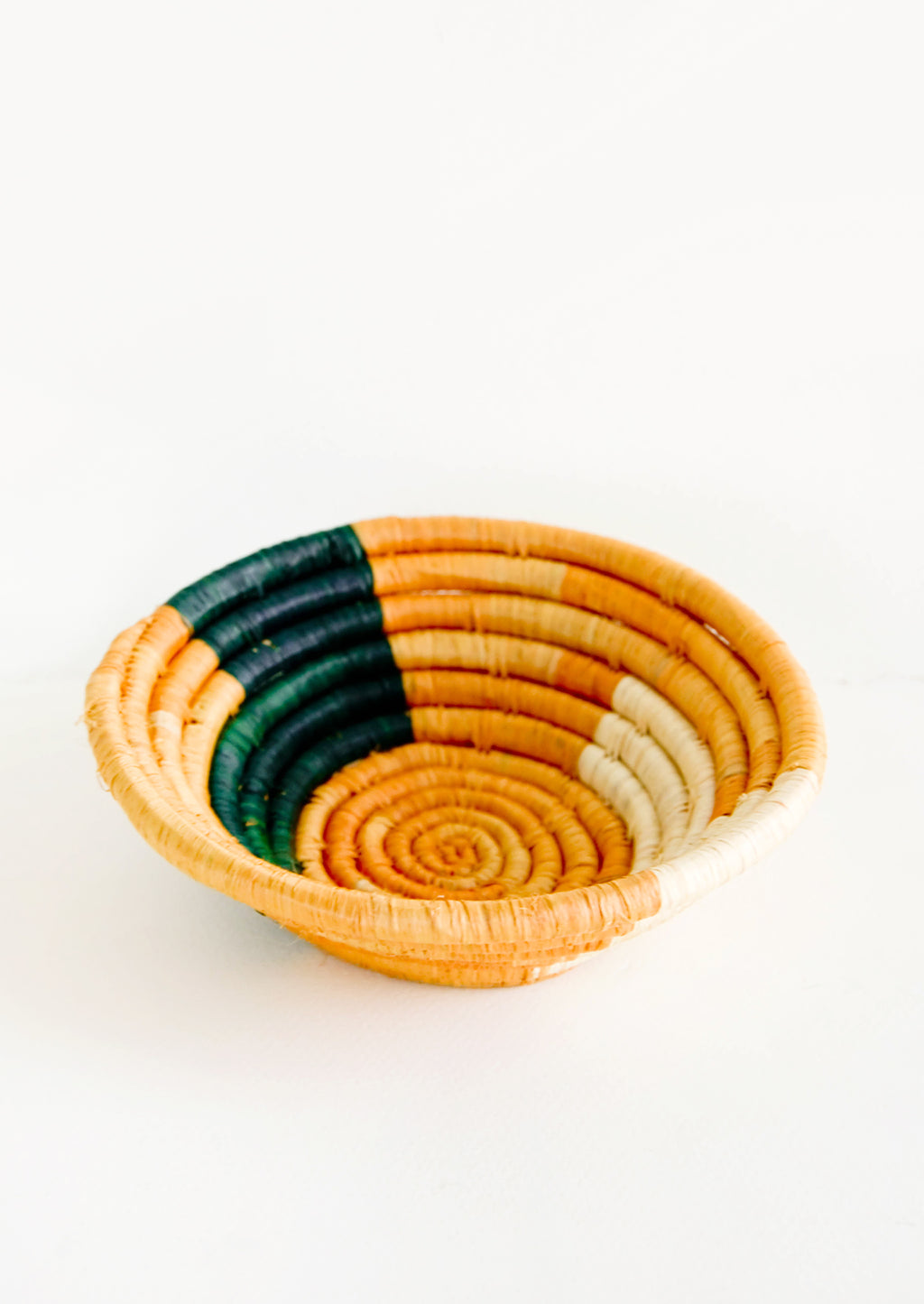 Goldenrod / Indigo Multi: Small raffia bowl in geometric pattern in mustard, green and natural