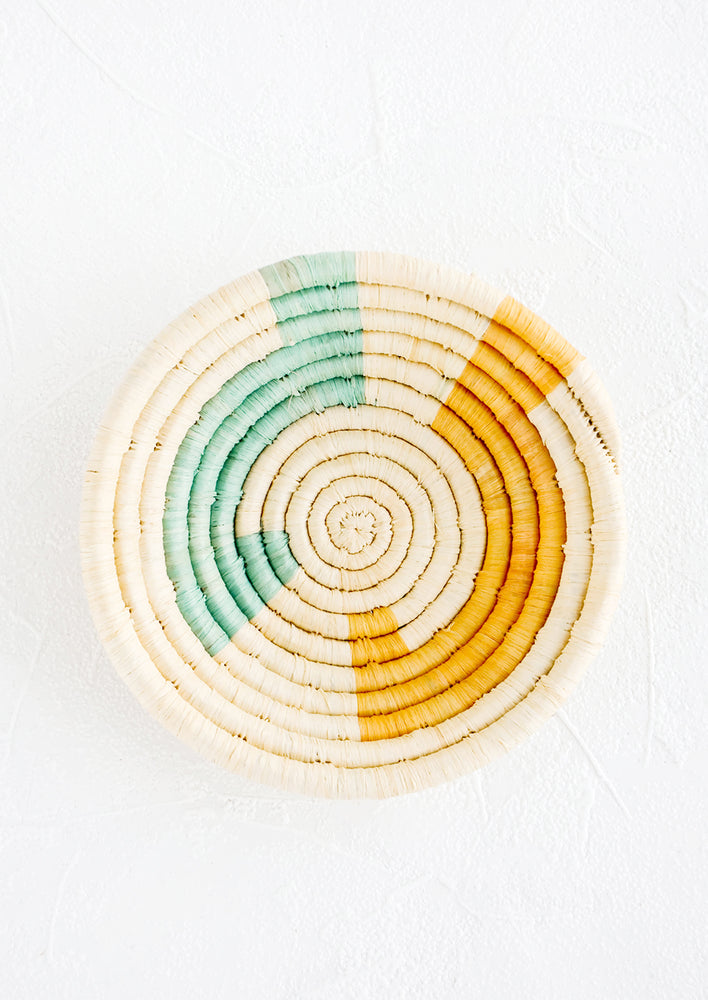 Natural / Aqua Multi: Small raffia bowl in geometric pattern in natural, aqua and yellow