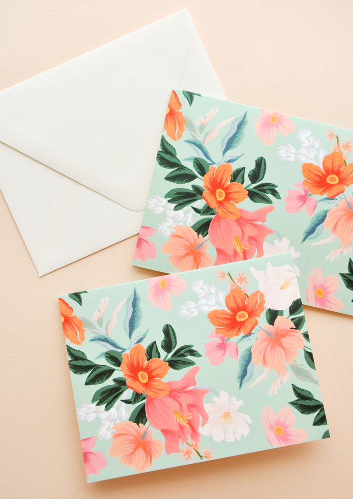 Mint: Set of mint green notecards with colorful floral decoration and white envelope.