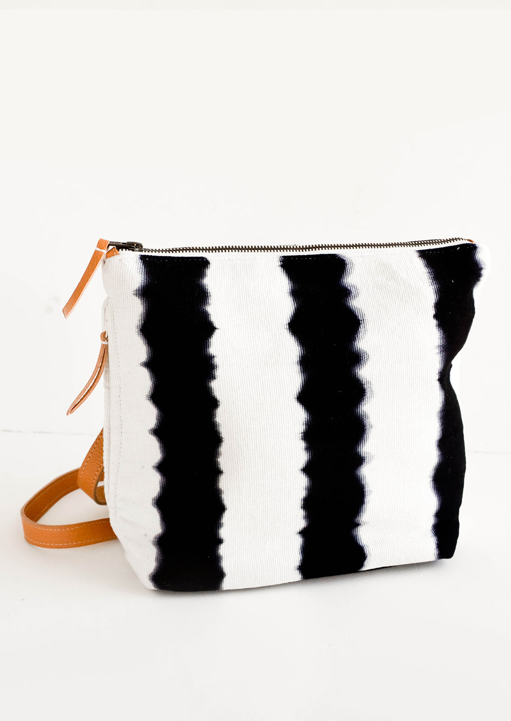1: Fashion backpack made from cotton canvas in black & white tie dye stripes with tan leather accents