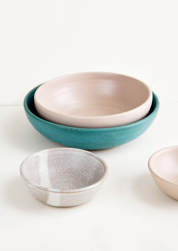 2: Grouping of handmade ceramic bowls in a mix of colors and sizes