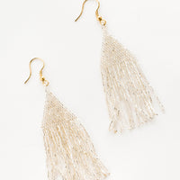 Silver: Metallic silver triangular fringe beaded earrings.