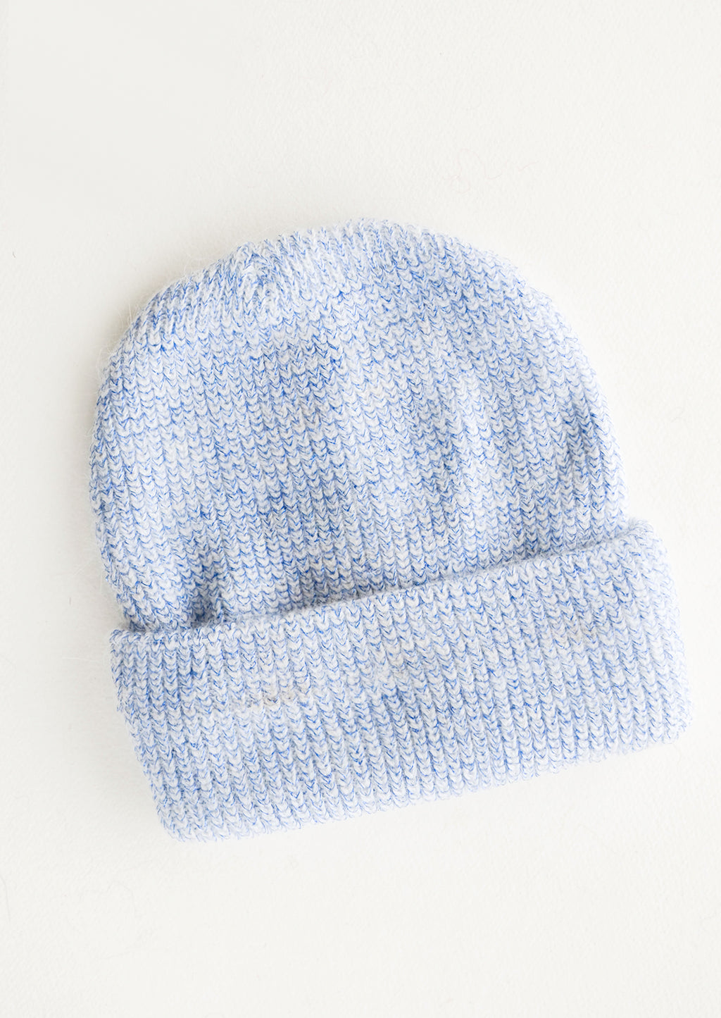 Blue: Blue and white herringbone stitch knit beanie with fold.