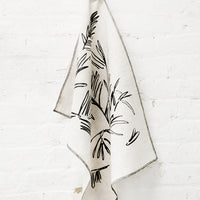 2: Screen Printed Palm Leaf Linen Tea Towel Hanging On Hook - LEIF