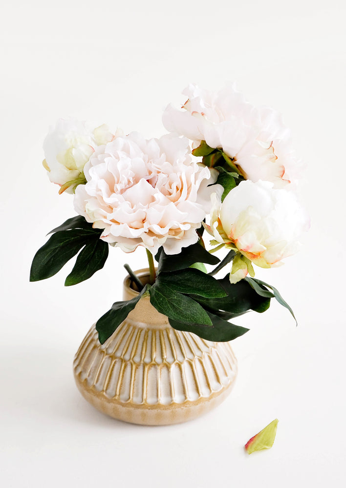 1: Wide and round vase with tapered opening, featuring allover etched line detailing. Shown with a bouquet of peonies.