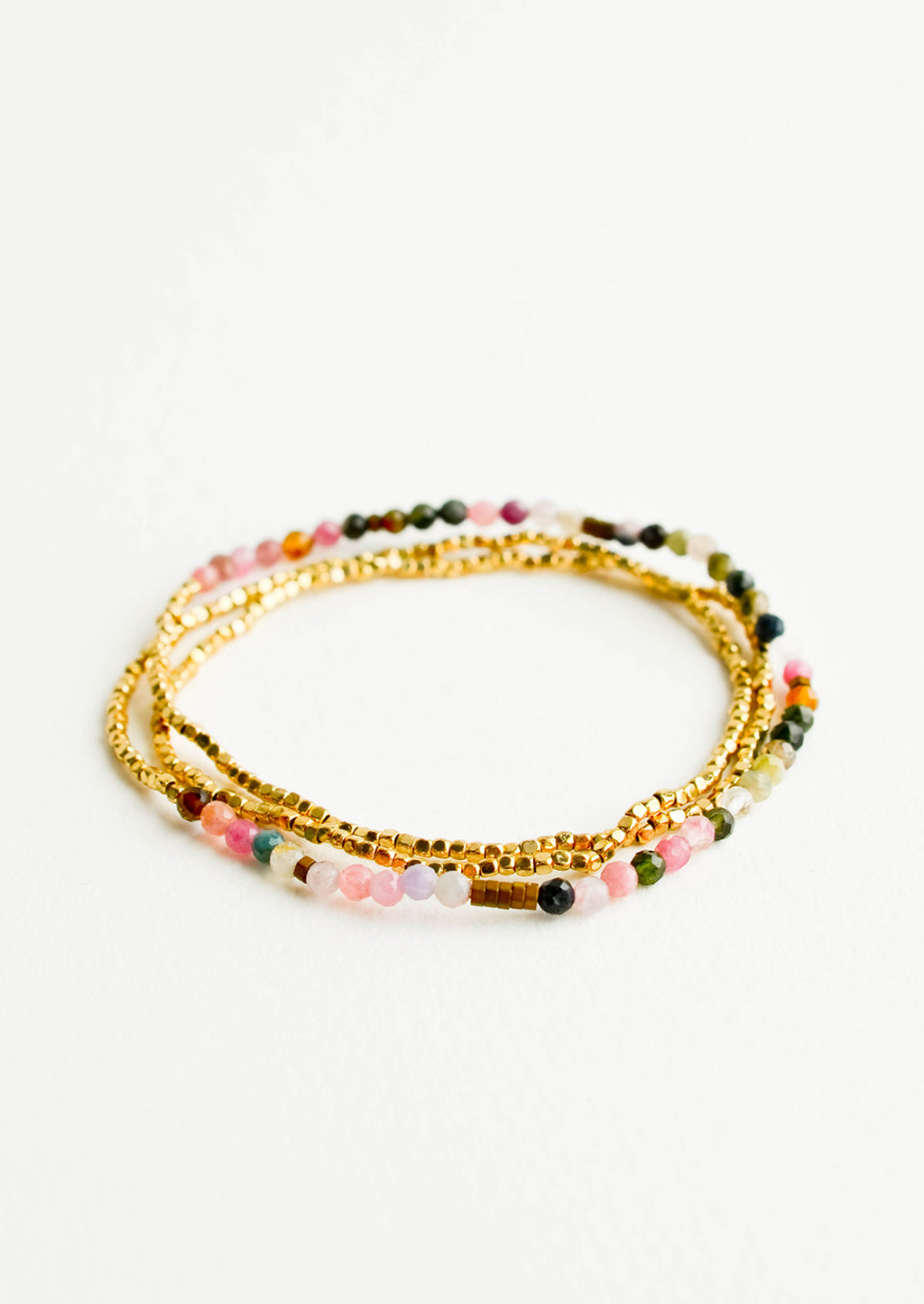 Tourmaline Multi: A single strand bracelet of gold and multi-colored beads wrapped upon itself in three layers.