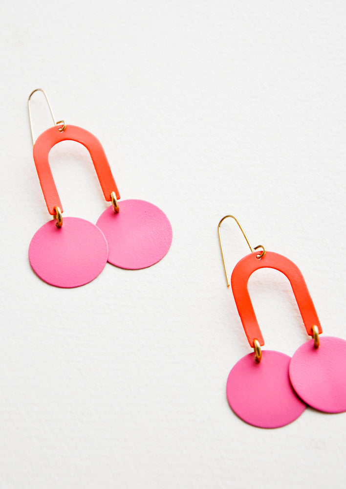 Coral / Pink: Two-toned pink earrings form a curved arc with two discs at each end.