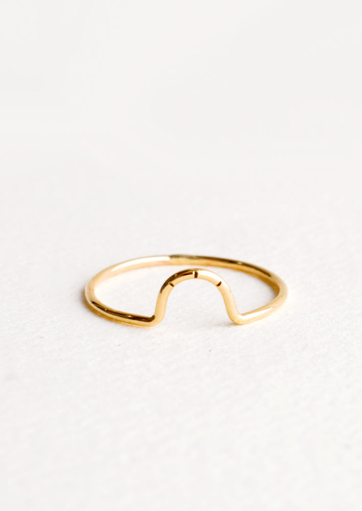 Thin gold ring showcasing small arced feature with three etched lines.