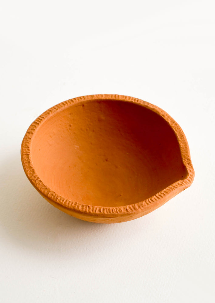 2: Terracotta clay bowl with spouted silhouette and textured rim
