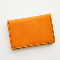 Oiled Saddle: A small leather cardholder wallet in tanned leather.