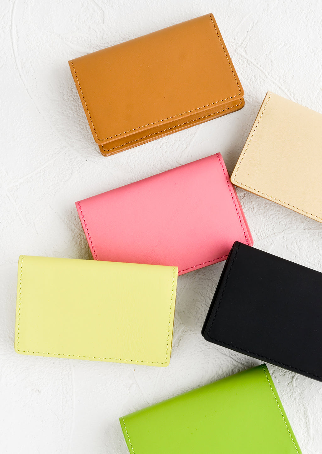 2: Leather card holder wallets in assorted colors.