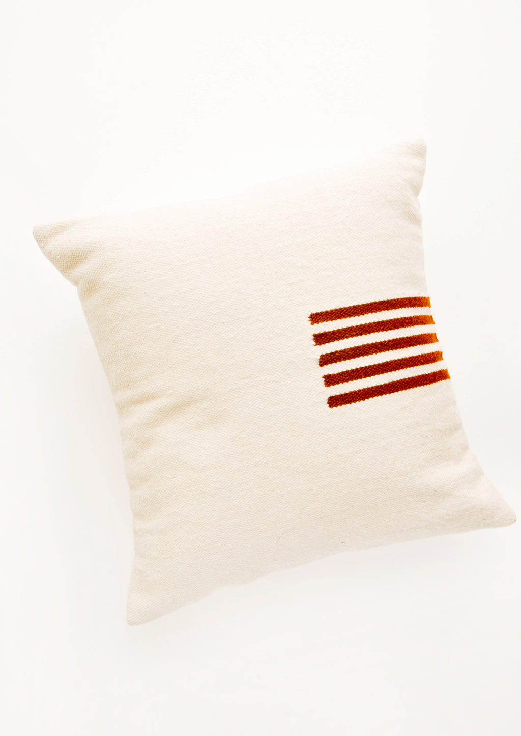 Natural / Terracotta: Ivory colored, square wool throw pillow with contrasting small stripe detail at side.