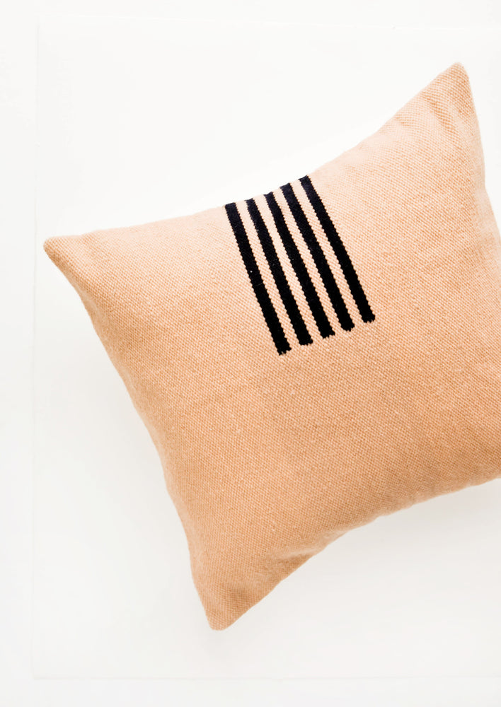 Peach / Navy: Peach colored, square wool throw pillow with contrasting small stripe detail at side.